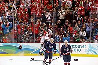 Hockey Photos - Sidney Crosby - Crosby (against glass) celebrates moments after scoring the gold-medal winning goal at the 2010 Winter Olympics over the United States.