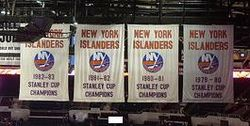 Hockey Photos - New York Islanders - These four banners hang in Nassau Veterans Memorial Coliseum and represent the four Stanley Cup championships the Islanders won from 1980 through 1983.