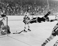 "Hockey Photos - Boston Bruins - Orr being tripped up by Noel Picard and flying through the air with his arms raised in victory after scoring ""The Goal"" in the 1970 Stanley Cup Final"