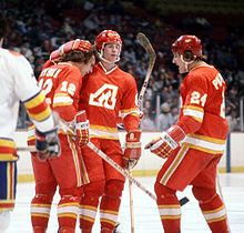 Hockey Photos - Calgary Flames - Tom Lysiak celebrates with teammates after a goal against the Colorado Rockies in 1978