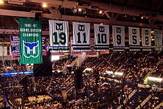 Hockey Photos - Hartford Whalers - Whaler banners and jerseys still hanging from the rafters of Hartford Civic Center in 2007.