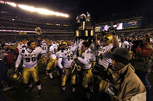 College Basketball Photos - Navy Midshipmen - Navy celebrates winning the Commander-in-Chief's Trophy after winning the 2005 Armyâ