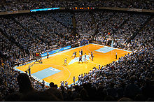 College Basketball Photos - North Carolina Tar Heels - Tip-off of a basketball game against Duke at the Dean Smith Center