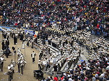 College Basketball Photos - Purdue Boilermakers - The Purdue All-American Marching Band perform <i>Hail Purdue</i> at the 2008 Purdue-Indiana football game.