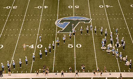College Basketball Photos - Tulane Green Wave - The Tulane University Marching Band performs the unofficial Fight Song