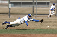 College Basketball Photos - Air Force Falcons - KJ Randhawa dives for a hard-hit ground ball