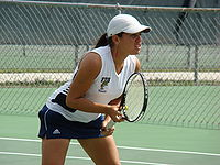 College Basketball Photos - Florida International Golden Panthers - Liset Brito of FIU during a women's tennis match vs. Louisiana-Lafayette at FIU in 2009.