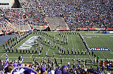 "College Football Photos - Northwestern Wildcats - The Northwestern University ""Wildcat"" Marching Band forms the ""Sculpted N"" and performs ""Go U Northwestern!"" to close its pregame performance at the 2005 Sun Bowl under the direction of Daniel J. Farris."