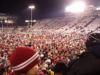 College Football Photos - Washington State Cougars - Cougar fans celebrate on the field after an Apple Cup win in 2004.
