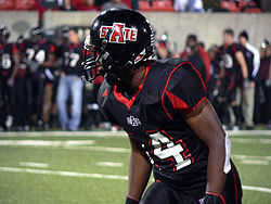 College Football Photos - Arkansas State Red Wolves - An Arkansas State football player wearing his home uniform.