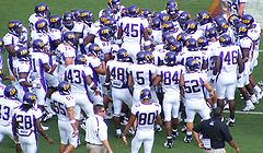 College Football Photos - East Carolina Pirates - The East Carolina Pirates gather at the sideline as they prepare to take on the 2007 Virginia Tech Hokies football team