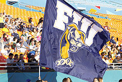 College Football Photos - Florida International Golden Panthers - Touchdown flag flown by the FIU Cheerleaders during the 7th annual Shula Bowl