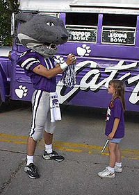 College Football Photos - Kansas State Wildcats - Willie the Wildcat entertains a young fan