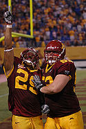 College Football Photos - Minnesota Golden Gophers - Amir Pinnix celebrates a touchdown with D.J. Burris on September 1