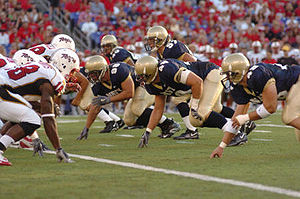 College Football Photos - Navy Midshipmen - A snap during the 2005 Navy-Maryland game.