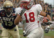 College Football Photos - New Mexico Lobos - The Lobos in action against Navy
