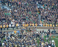 College Football Photos - Notre Dame Fighting Irish - Team raising their helmets to the student section after a win (or loss)