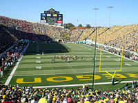 College Football Photos - Oregon Ducks - The first play of the 2007 game between Oregon and USC