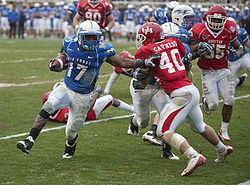 College Football Photos - Air Force Falcons - Running back Asher Clark and the Falcons take on the Houston Cougars during the 2009 Armed Forces Bowl