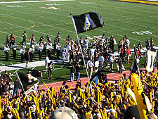 College Football Photos - Appalachian State Mountaineers - The Mountaineer football team gathers on the sideline