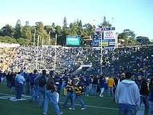College Football Photos - California Golden Bears - Big Game at California 2006. Cal fans rush the field.
