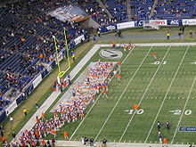 College Football Photos - Clemson Tigers - The Clemson Tigers take the field during the 2009 Music City Bowl.