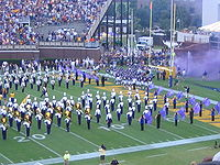College Football Photos - East Carolina Pirates - The football team running onto the field before a game