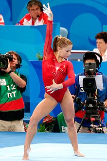 Olympics Photos - Shawn Johnson - Johnson performs on the floor at the 2008 Beijing Olympics