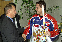Olympics Photos - Pavel Bure - Bure with Russian President Vladimir Putin at a Spartak Cup match between Russia and the Czech Republic on August 14
