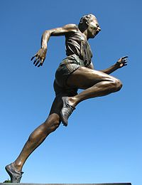 Olympics Photos - Betty Cuthbert - Statue of Betty Cuthbert outside the Melbourne Cricket Ground