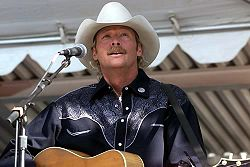 Olympics Photos - Alan Jackson - Alan Eugene Jackson with his guitar.