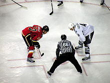Olympics Photos - Jarome Iginla - Iginla faces off against Vincent Lecavalier.