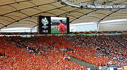 Soccer Photos - Netherlands National Football Team - Dutch fans wearing the traditional orange colours of the national team at a 2006 World Cup match at the Gottlieb-Daimler-Stadion