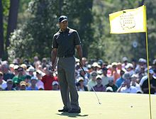 Golf Photos - Tiger Woods - Woods on the green at The Masters in 2006.