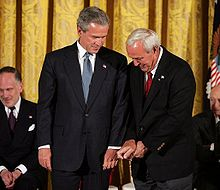Golf Photos - Arnold Palmer - Palmer gives President Bush golf tips before being awarded the Presidential Medal of Freedom