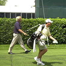 Golf Photos - Greg Norman - Greg Norman practicing for the Buick Classic at Westchester Country Club