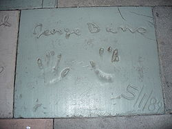 Golf Photos - George Burns - The handprints of George Burns in front of The Great Movie Ride at Walt Disney World's Disney's Hollywood Studios theme park.