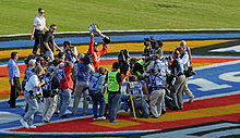 Motorsports Photos - Carl Edwards - Edwards celebrating after clinching the 2007 Busch Series Championship after the fall Texas race.