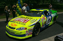 Motorsports Photos - Kenny Irwin, Jr. - Kenny Irwin's car with a Project Impact logo May 2000