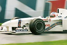 Motorsports Photos - Jackie Stewart - Rubens Barrichello driving for Stewart's F1 team in 1997.