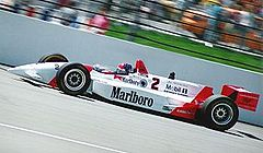 Motorsports Photos - Emerson Fittipaldi - Emerson Fittipaldi racing in the Indianapolis 500 in 1994