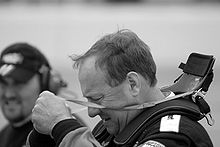 Motorsports Photos - Ken Schrader - Schrader putting on his HANS device