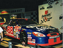 Motorsports Photos - Dale Jarrett - Dale Jarrett's 2000 Daytona 500 winning car on display at Daytona USA
