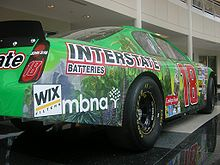 Motorsports Photos - Bobby Labonte - Bobby Labonte's former JGR car on display at the Joe Gibbs Racing headquarters.