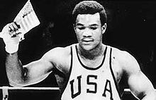 Boxing Photos - George Foreman - A young George Foreman celebrates his Olympic triumph.