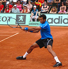 Tennis Photos - Jo-Wilfried Tsonga - Tsonga during an exhibition match prior to the 2009 French Open.