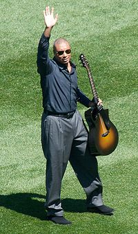 Baseball Photos - Bernie Williams - Williams greeting fans during a pregame musical performance at the new Yankee Stadium in 2009