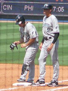Baseball Photos - Andy Fox - Fox (right) with Marlins outfielder Cody Ross in 2008.