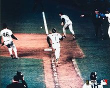 Baseball Photos - Bill Buckner - Game 6: Ray Knight (not pictured) scores the winning run as Bill Buckner and Bob Stanley watch Mookie Wilson's slow roller.