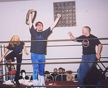 Sports Photos - Dude Rock - Dude Rock celebrates with Andy Runyon after winning the RCW Extreme Title